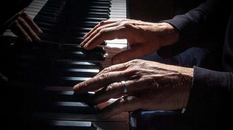 Frank Scafuri plays the piano at his home