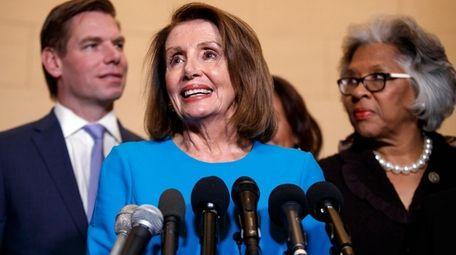 House Minority Leader Nancy Pelosi, D-Calif., center, speaks