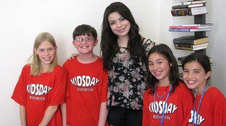 Actress Miranda Cosgrove with Kidsday reporters Rebecca Fregoe,