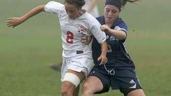 Connetquot's Raychel Diver (left) and Northport's Ashlee Burke
