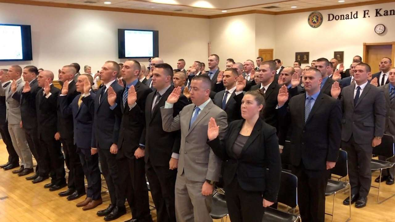 In Mineola on Friday, 64 new Nassau County police