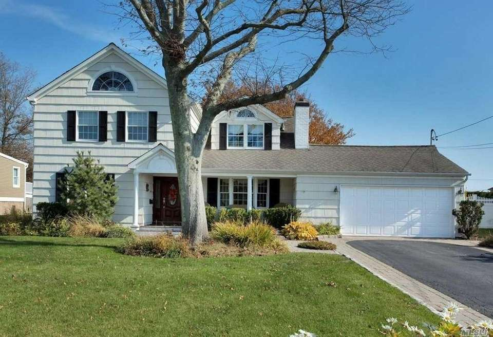 This West Islip Colonial includes four bedrooms and