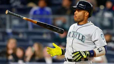 Robinson Cano  of the Seattle Mariners flips