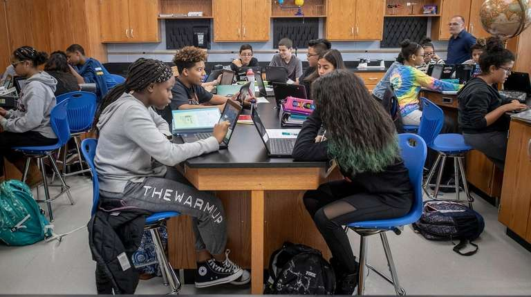 Seventh-grade Honors Science students at J.W. Dodd Middle