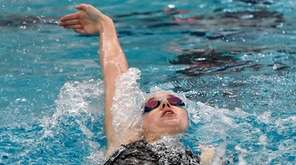 Port Jefferson's Kyra Sommerstad swims in the finals