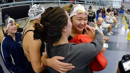 Great Neck South's Jessica Whang, facing, is congratulated