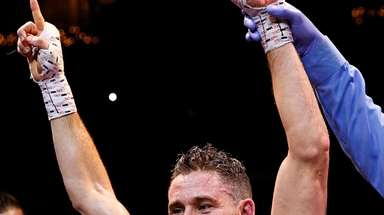 Chris Algieri celebrates his win via decissionover Angel