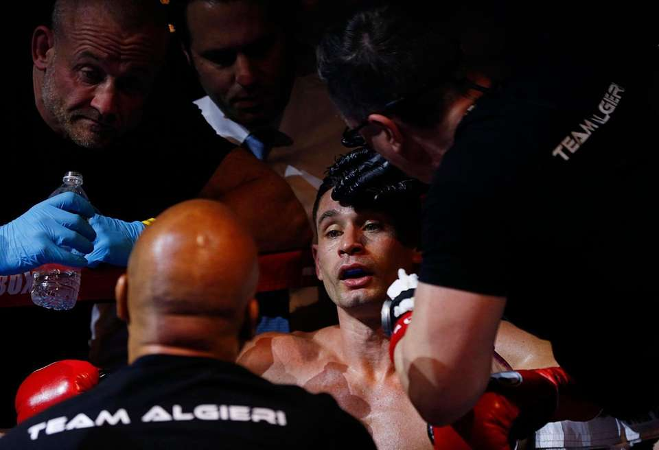 Chris Algieri listens to the corner man during