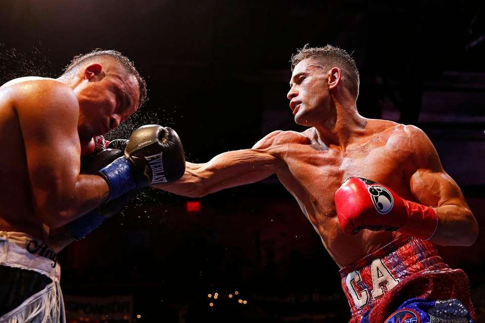 Chris Algieri punches Angel Hernandez during the boxing