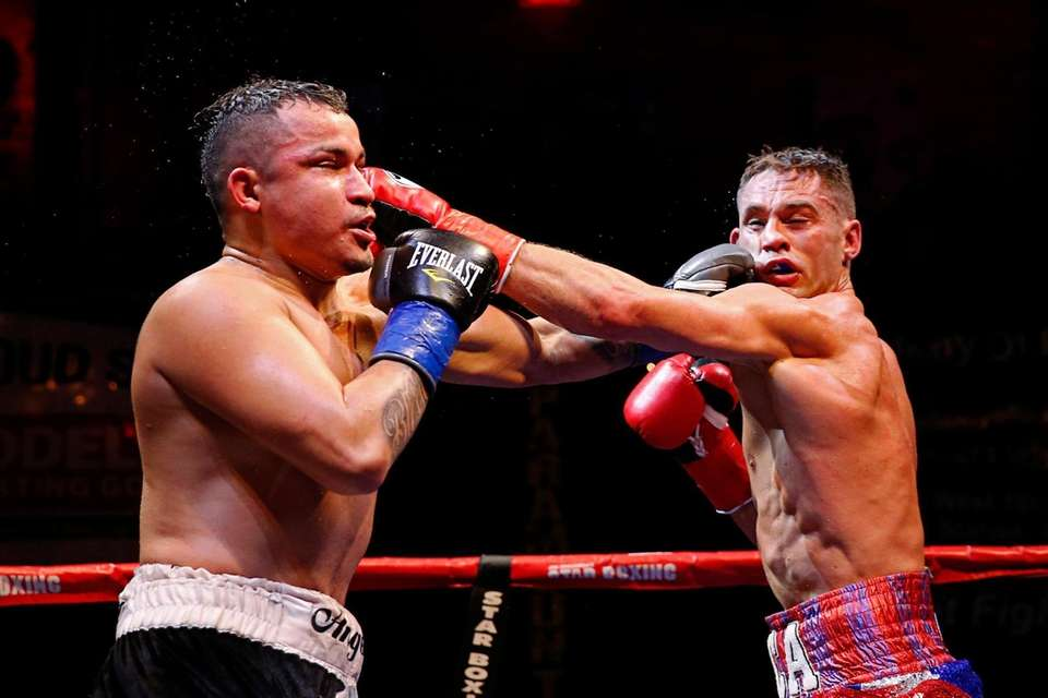 Chris Algieri and Angel Hernandez in action during