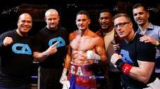 Chris Algieri and his team celebrate after defeating