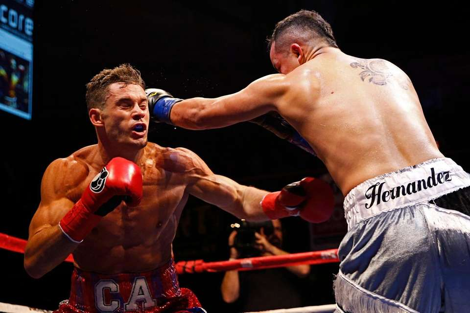 Angel Hernandez and Chris Algieri in action during