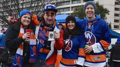 Islanders fans Corinne Rowe, James Fesselmeyer, Kelly Meenan