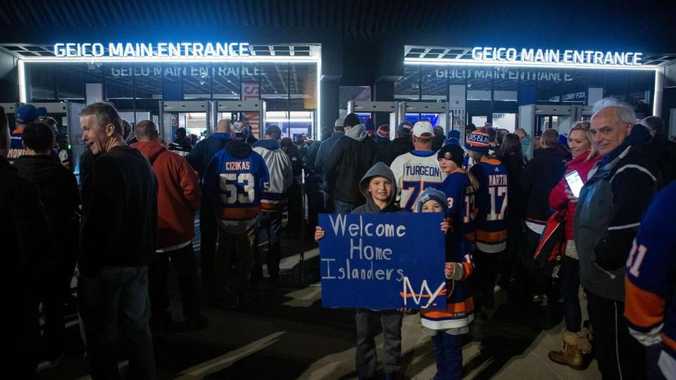 New York Islander fans wait outside to watch