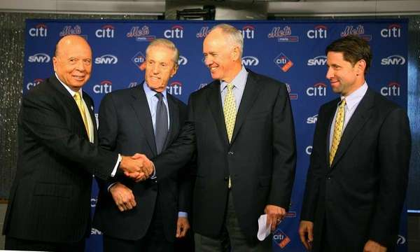 Mets GM Sandy Alderson, second from right, stands