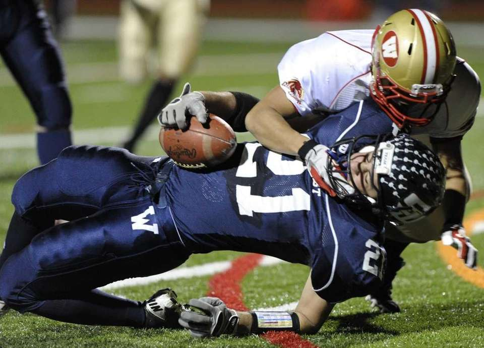 Smithtown West's Anthony Gatto tackles by a Half