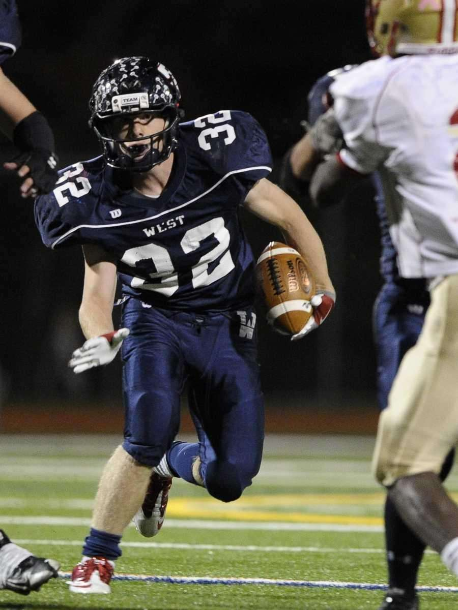 Smithtown West's #32 gains yardage in the Suffolk