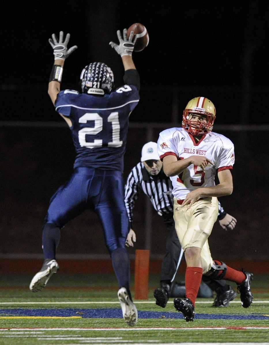 Smithtown West's Anthony Gatto (foreground) tips a pass