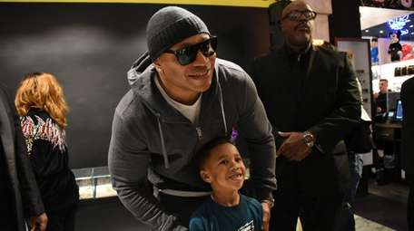 LL Cool J poses for a photo with