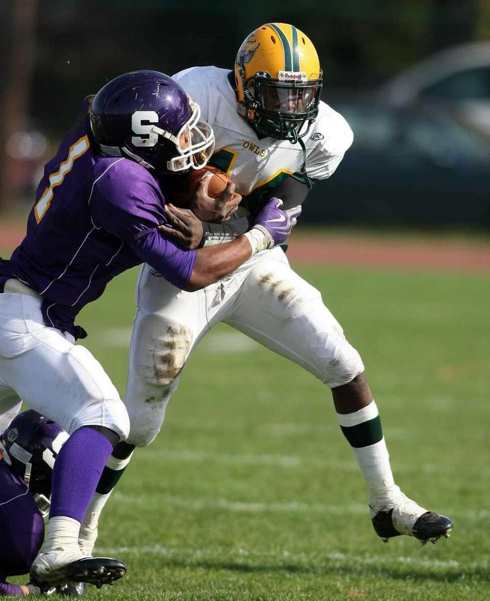 Lynbrook's QB #14 Paul Magliore trys breaking the