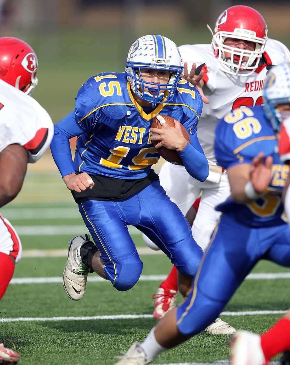 West islip quarterback Anthony Santo (15) with a