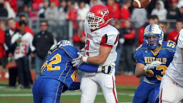 West Islip's Pat Ryan (22) knocks the ball