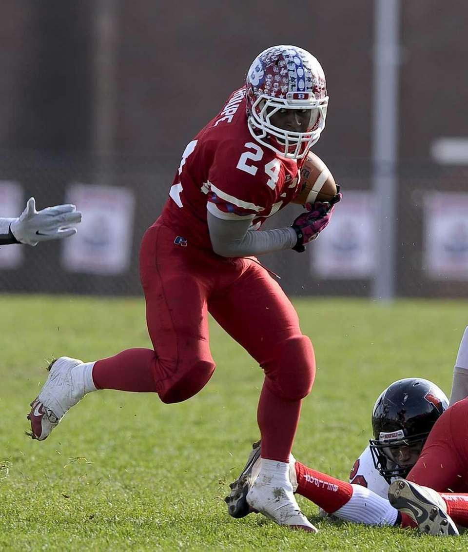Bellport's Travis Houpe looks to elude a tackle