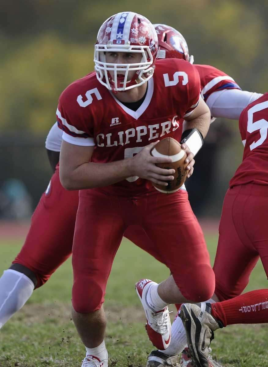 Bellport quarterback Justin Honce looks to pass during