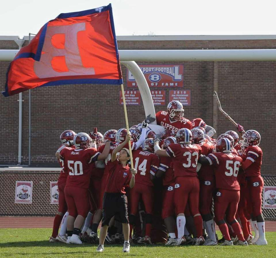 Bellport's football team takes the field. (Oct. 30,