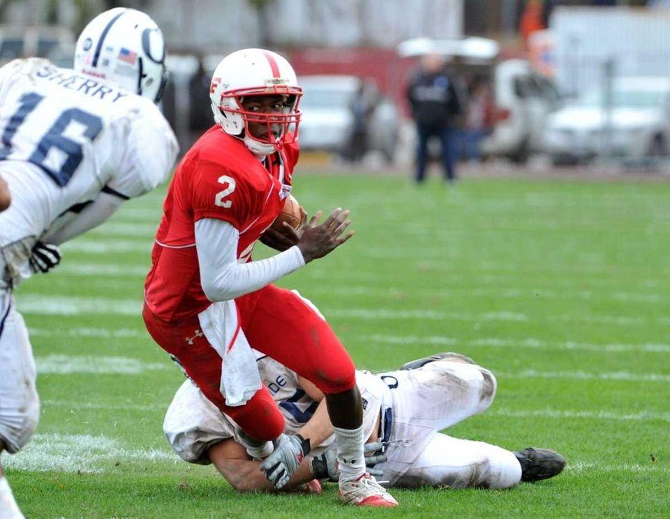 Freeport Red Devils quarterback Isaiah Barnes (2) runs