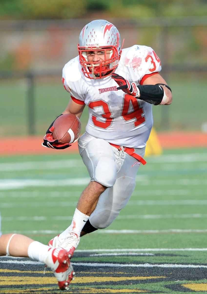 Connetquot's #34 Mike Pellegrino rushes for one of