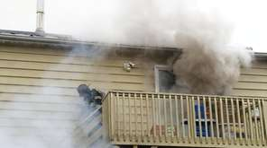 A Brentwood Fire Department firefighter works at a