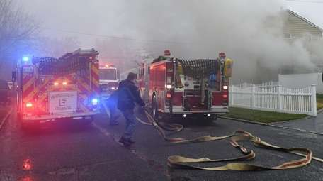 Brentwood Fire Department firefighters douse a fire at