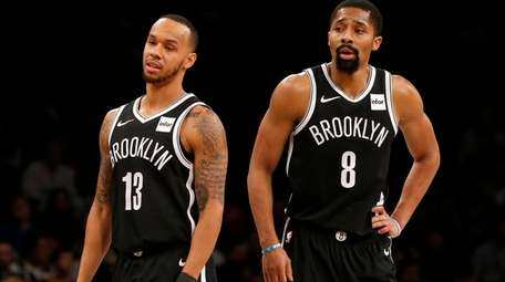 Shabazz Napier #13 and Spencer Dinwiddie #8 of