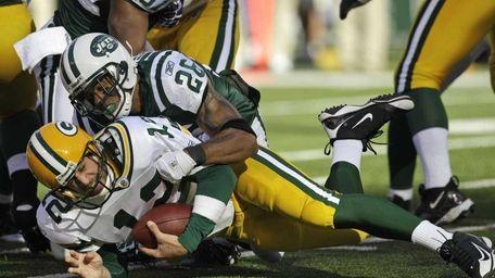 Jets cornerback Dwight Lowery sacks Green Bay's Aaron