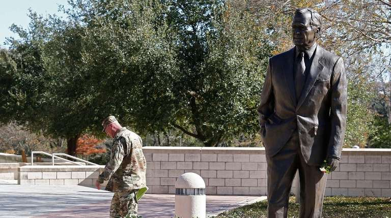 A statue of George H.W. Bush outside the