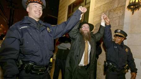 Rabbi Aaron Konikov celebrates the first night of