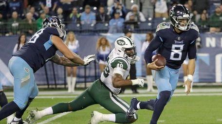 Tennessee Titans quarterback Marcus Mariota (8) gets past