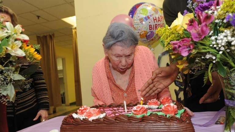 Goldie Steinberg blows out two candles on her