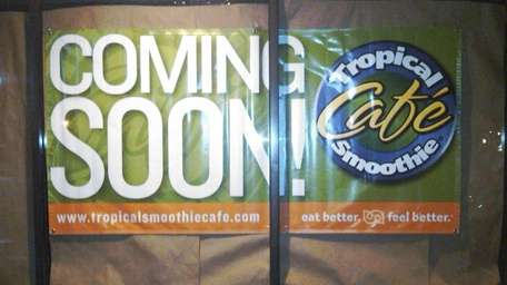 Sign announcing Tropical Smoothie Cafe in Huntington. (October