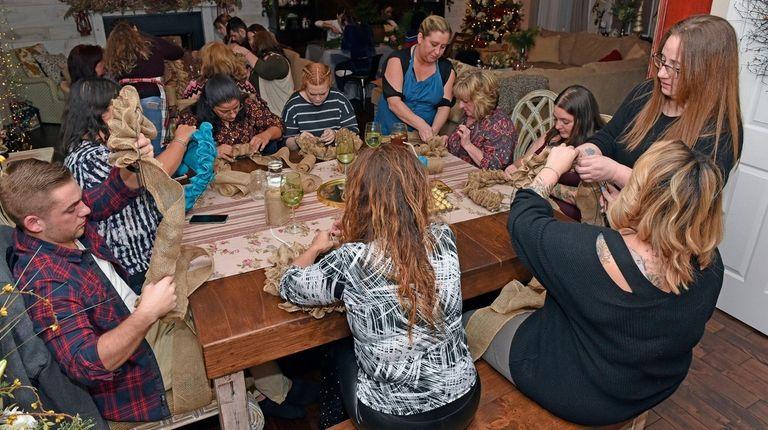 Janeen Barnes' guests make burlap wreaths at her