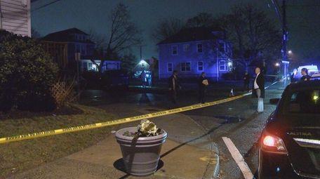 Suffolk County police investigate a scene where shots