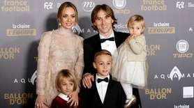 Real Madrid's Luka Modric arrives with his family