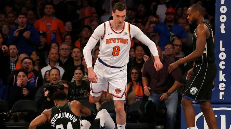 Mario Hezonja of the Knicks steps over Giannis