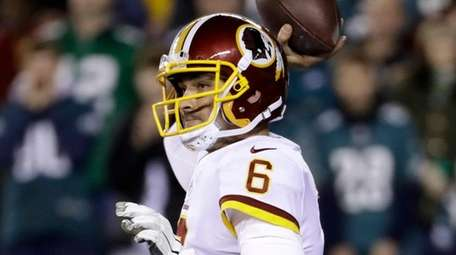 Redskins quarterback Mark Sanchez passes during the first