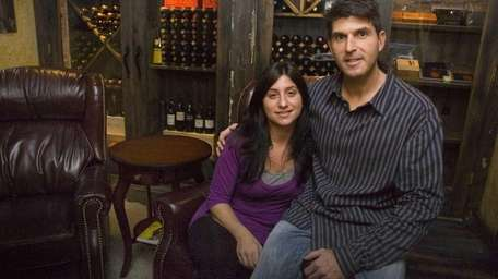 Larry and Jennifer Golus, pictured in their wine