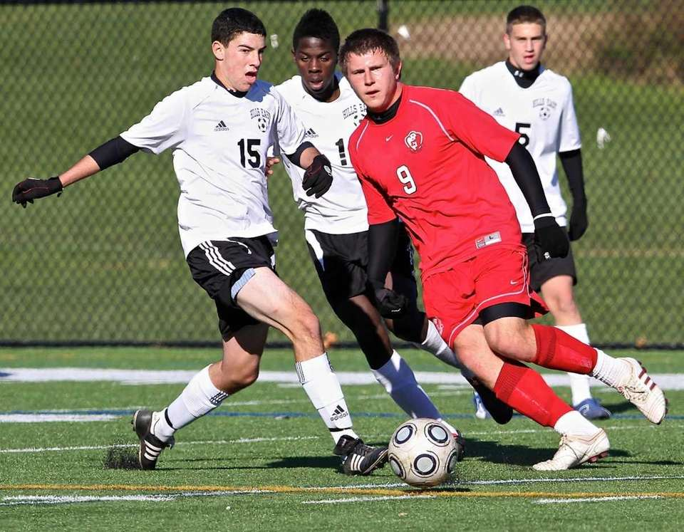 East Islip forward Keith McKenna, right, dribbles the