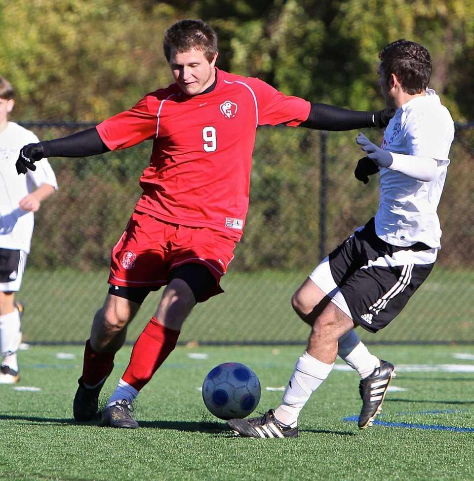 East Islip forward Keith McKenna (9) moves the