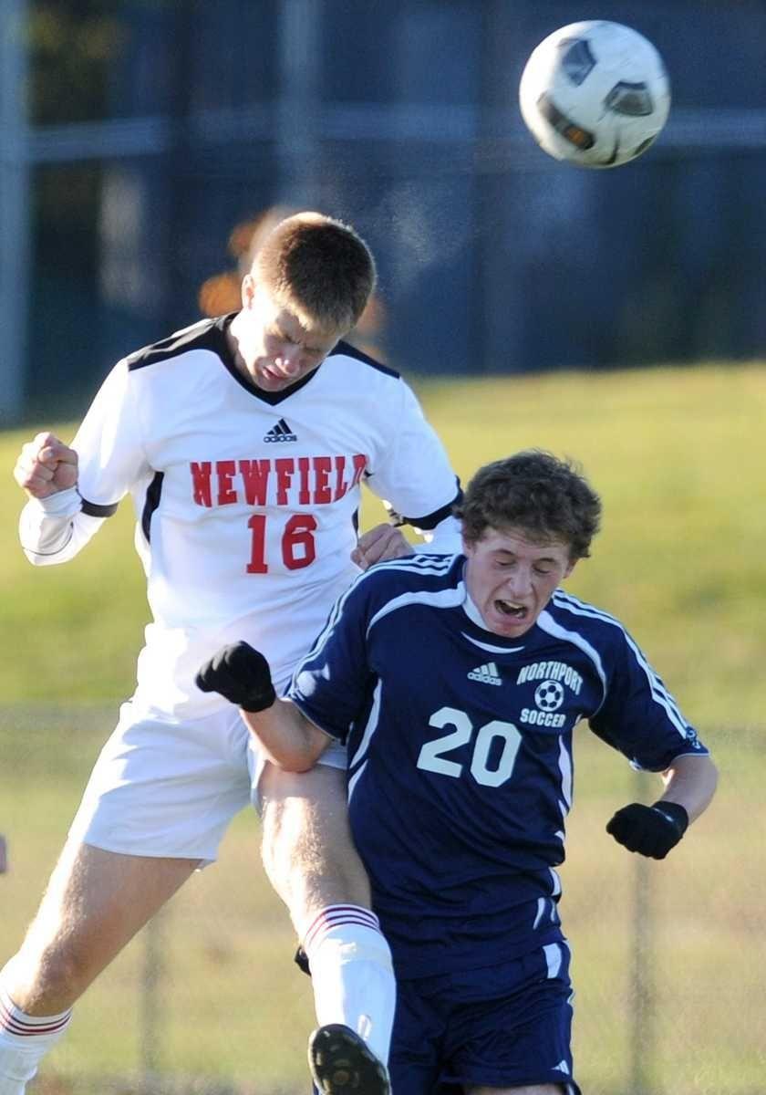 Newfield's Sam Durkot, left, heads a ball away
