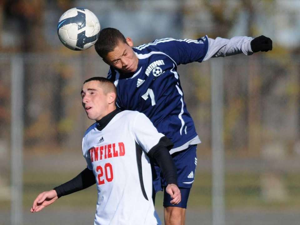 Northport's Malcolm Comma, right, leaps above Newfield's Steven
